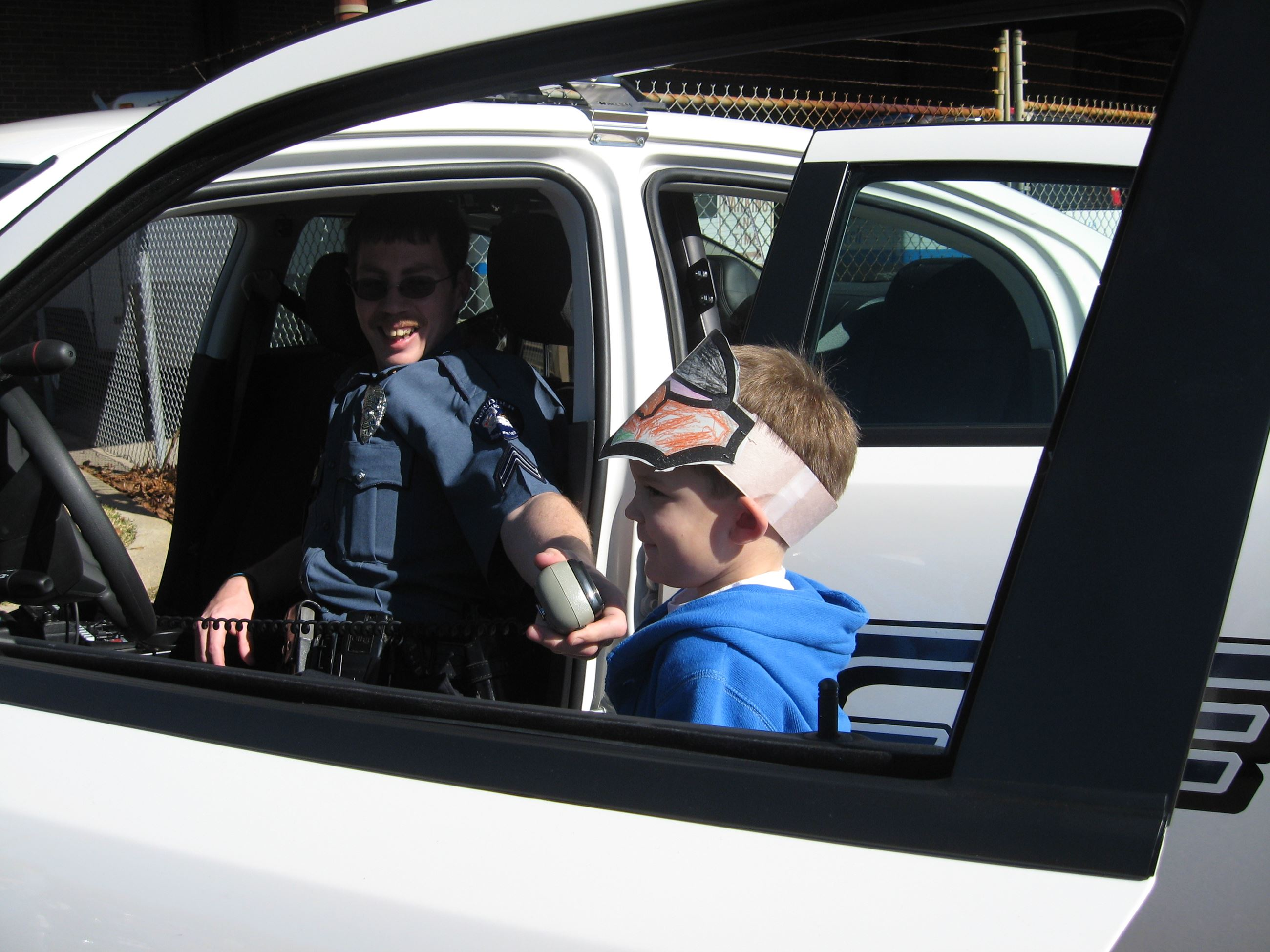 Officer Lets Child Use Car Radio