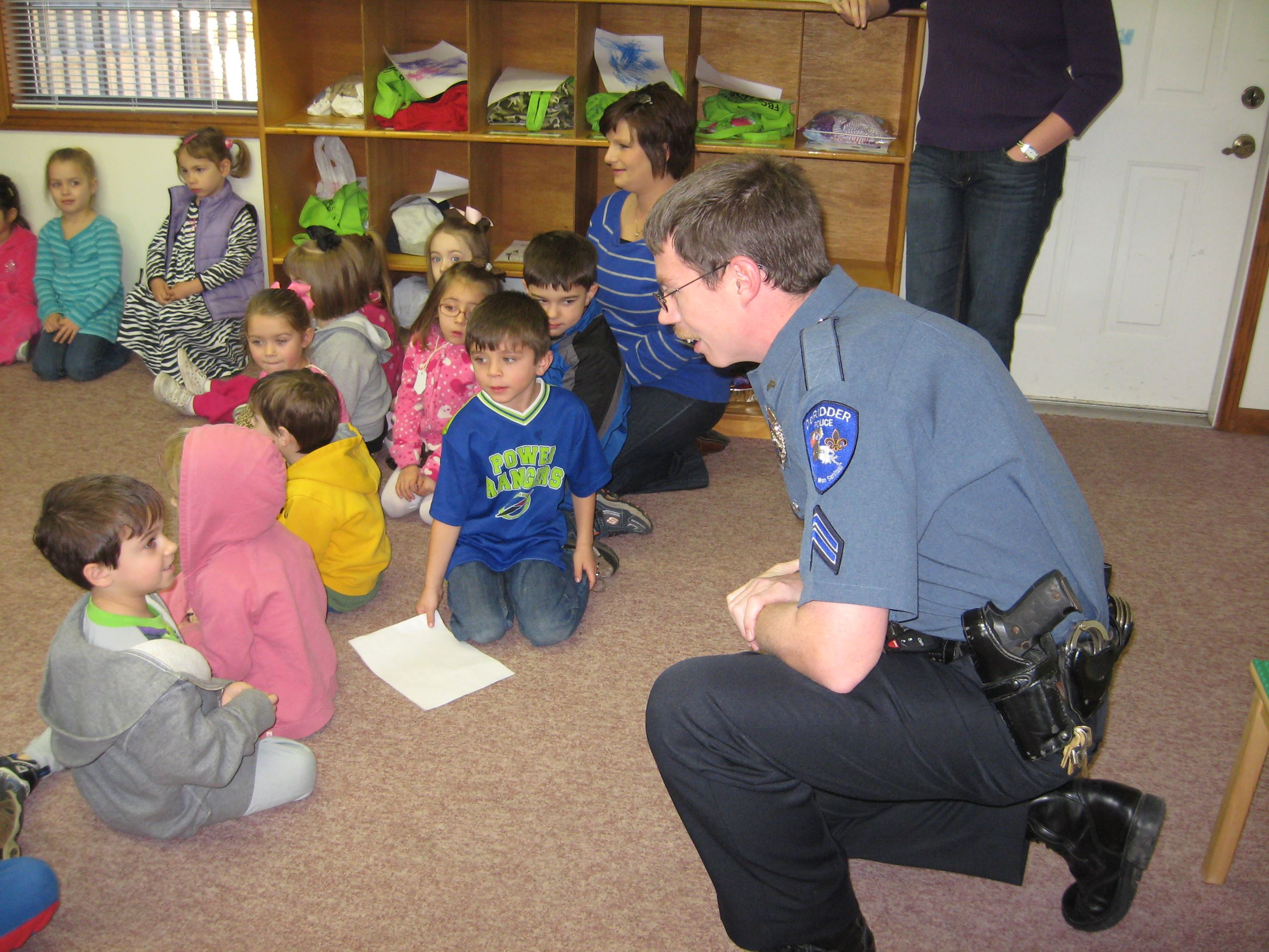 Officer Talks to Children in a Classroom